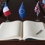 Open spread book, fountain pen, EU (European Union) flags